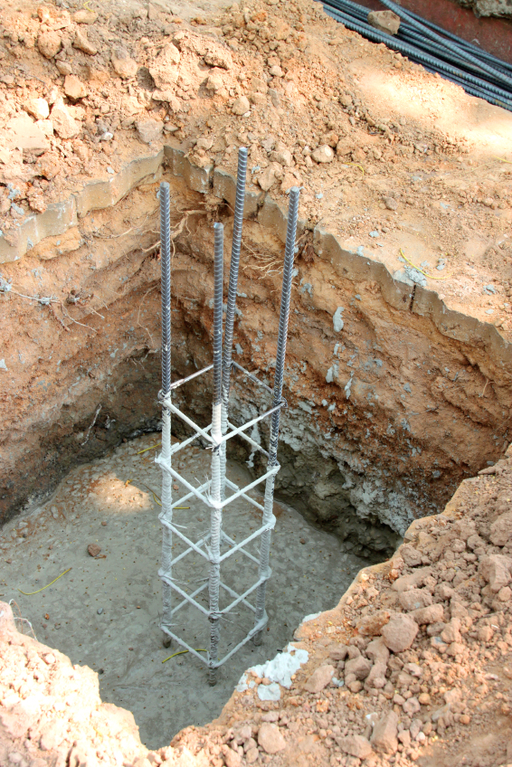 hole of metal foundation post in building site